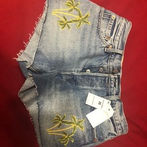 Levi's 501 high waisted shorted with palm trees